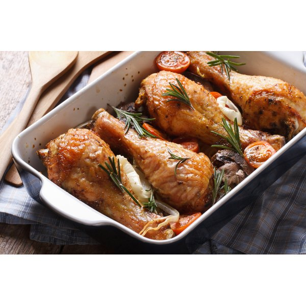 Baked chicken thighs in a pan.