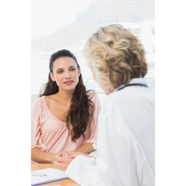Young woman talking with doctor.