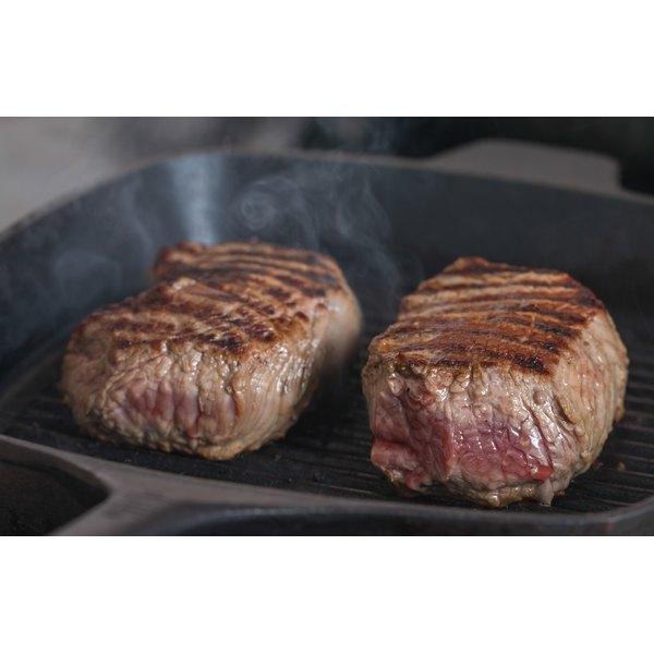 Two steaks in a frying pan.