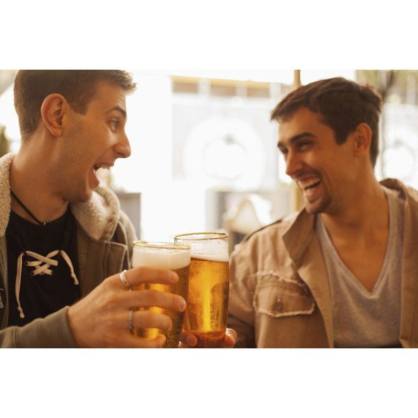 Two men toasting glasses of beer.