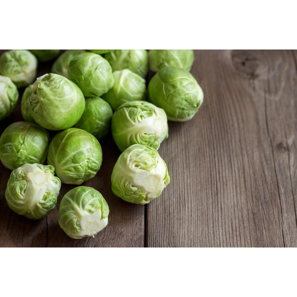 Brussels sprouts on a wooden table.