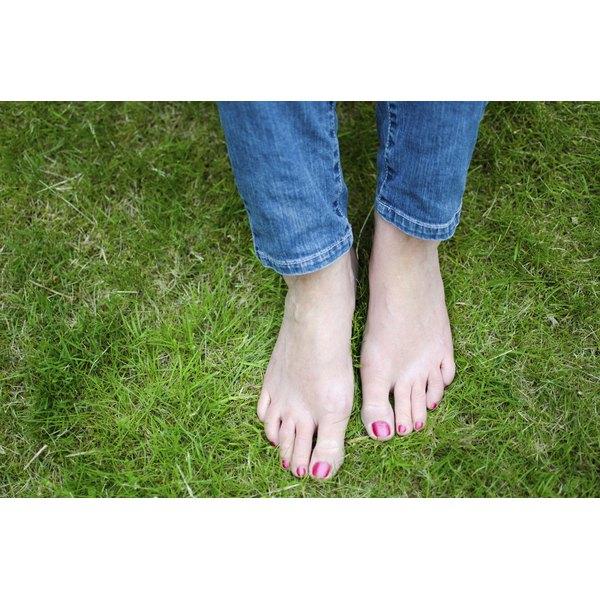 feet standing in grass