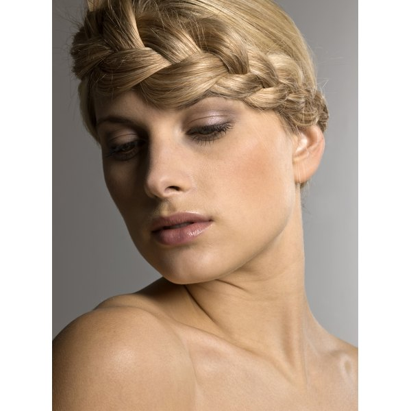 A French braid will sit neatly around the hairline.