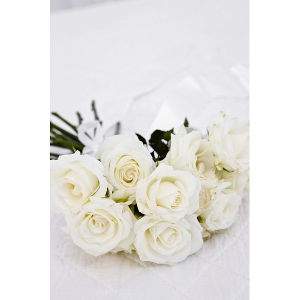 Satin ribbon roses embellish bridal and wedding decorations.