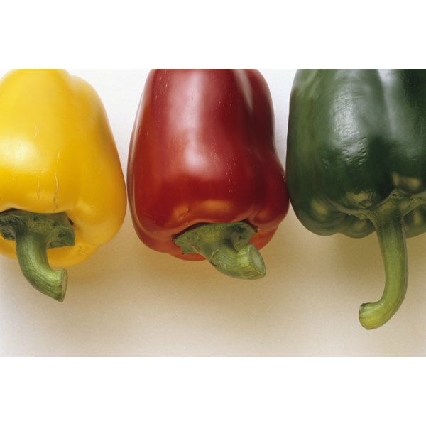 An assortment of bell peppers on a table.