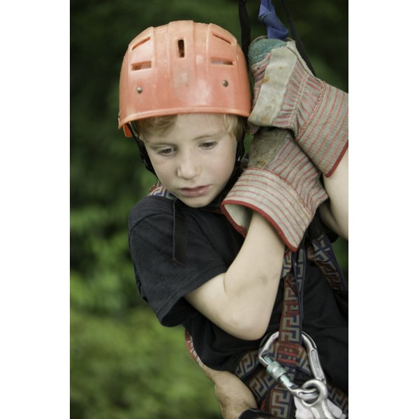 Young boy building self esteem while zip lining.