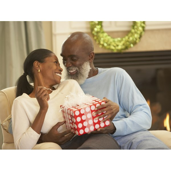 Man giving his wife a present.