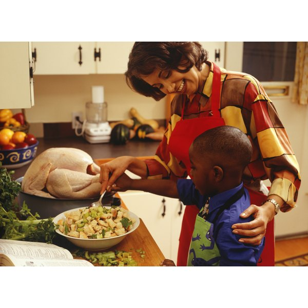 A mother and son prepare a Thanksgiving dinner.
