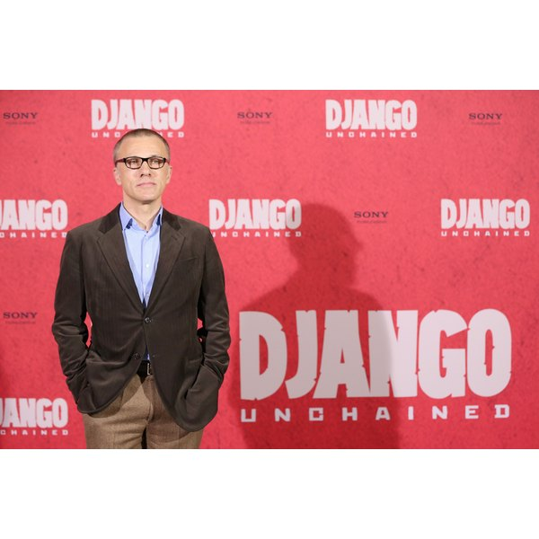 Christoph Waltz wore an icy blue button-down shirt with a dark brown sport coat to a 2013 movie premier at the Hotel de Rome in Berlin, Germany.