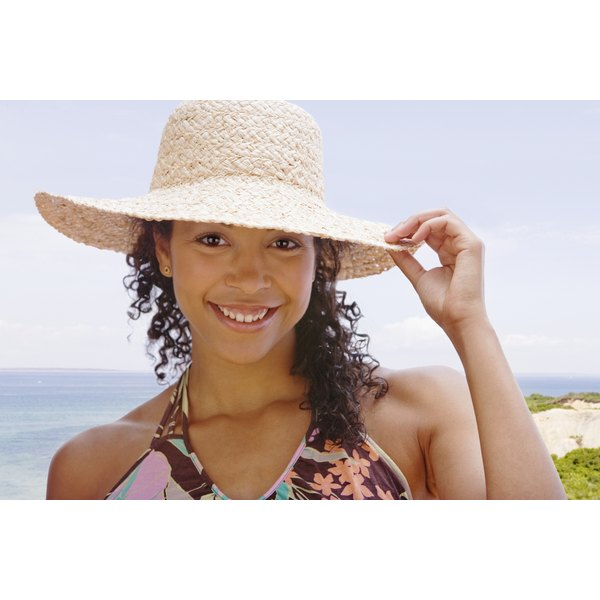 Young woman wearing a hat on the beach