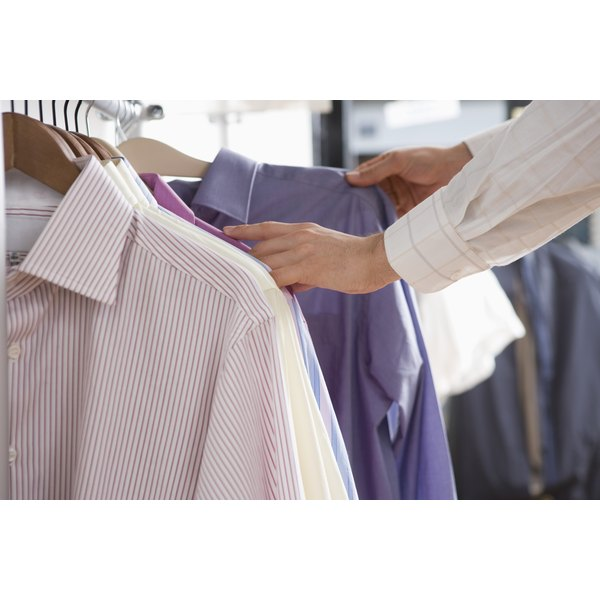 Examine garment tags to confirm whether your clothing is made of cotton, polyester or a blend of the two fibers.