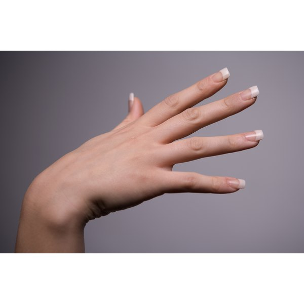 Achieve nails that look natural by applying acrylic nails.