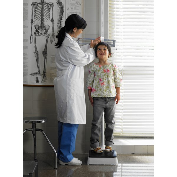 child being measured at the doctor's office