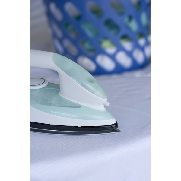Use a steam iron to flatten rubber.