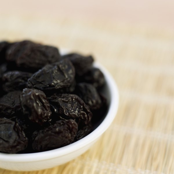 A small bowl of prunes.