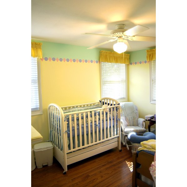 A crib canopy can enhance your nursery decor.