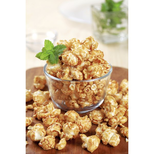 Make your snack lighter by using air-popped popcorn.