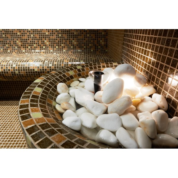 A pile of hot rocks in a tiled steam room.