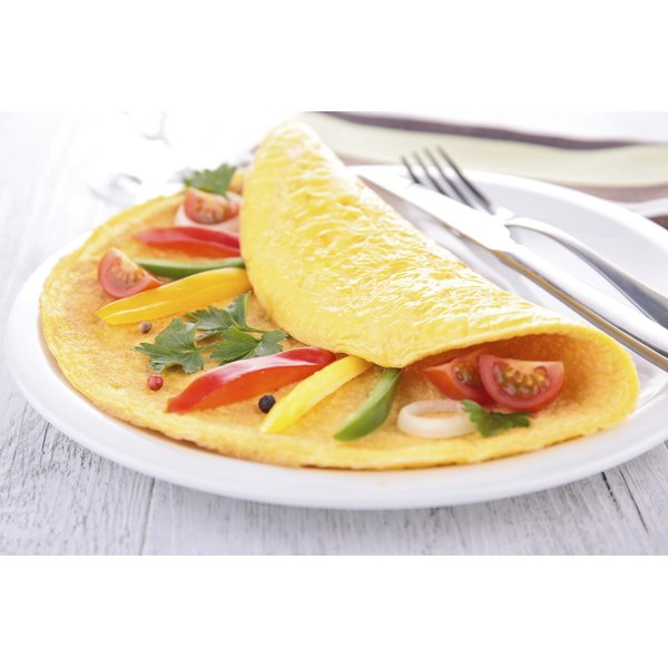 A vegetable omelet on a breakfast plate.