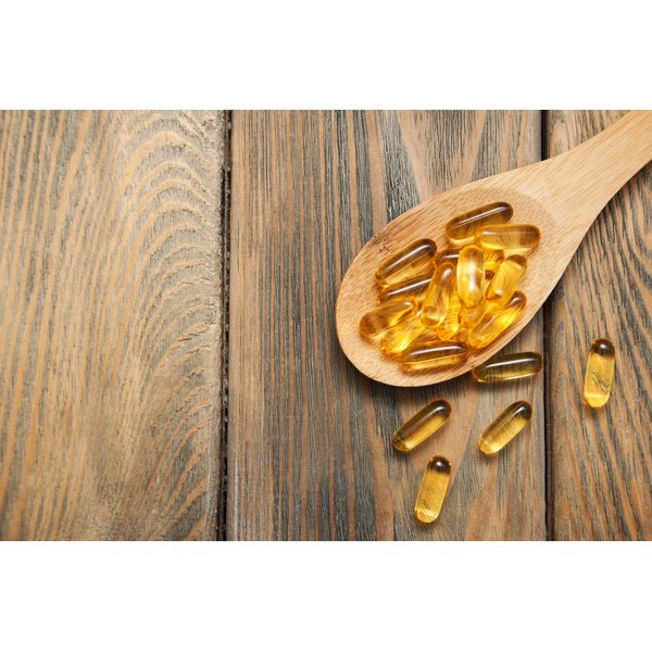 Vitamins in a wooden spoon