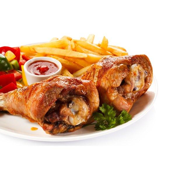 Roasted turkey legs and vegetables.