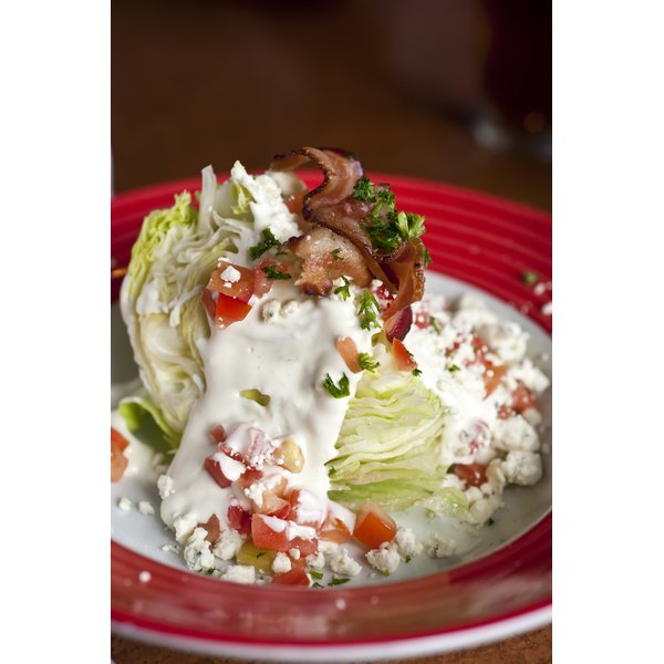Iceberg lettuce and a thick, creamy dressing are the foundation of a wedge salad.