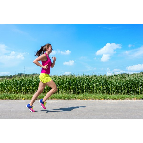A young lady or teen is jogging in the country side.