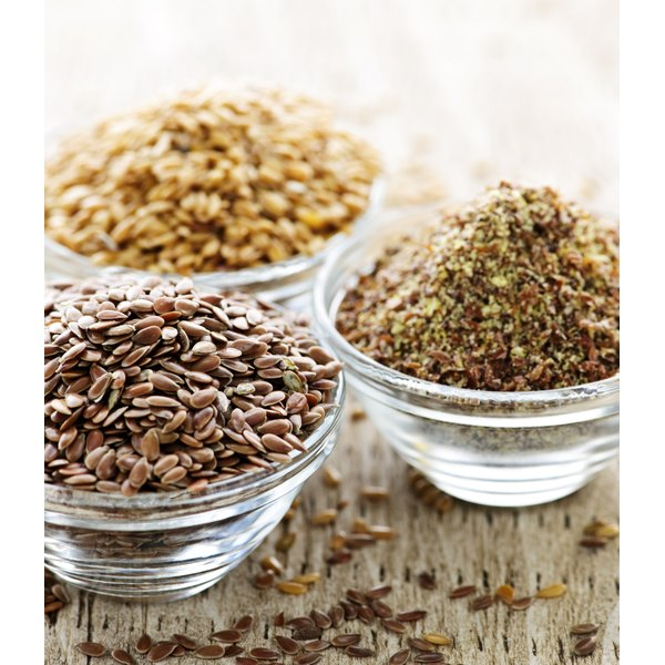 Various flaxseed in bowls on a table.