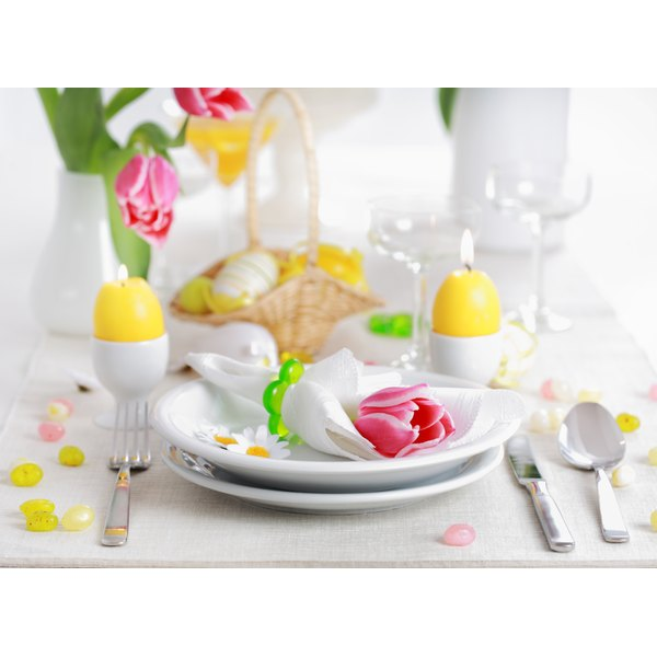 Simple yellow candles in budget-friendly egg cups brighten up the Easter table.