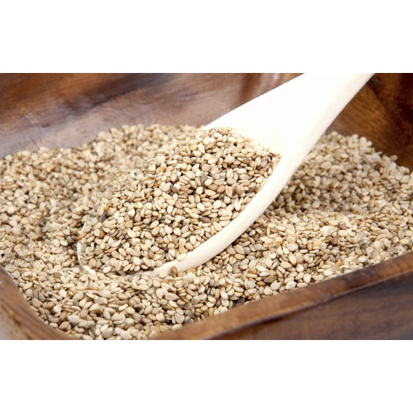 Sesame seeds in a wooden bowl.