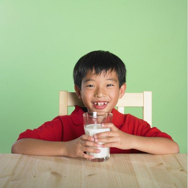 Boy drinking a glass of milk.