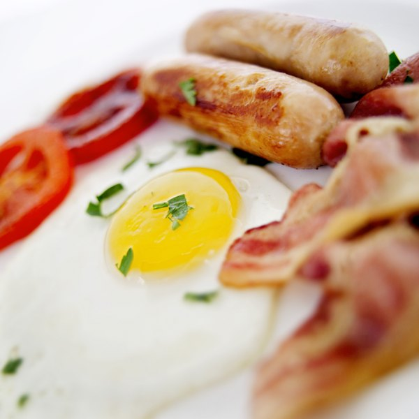 A plate of eggs, bacon, and sausage.