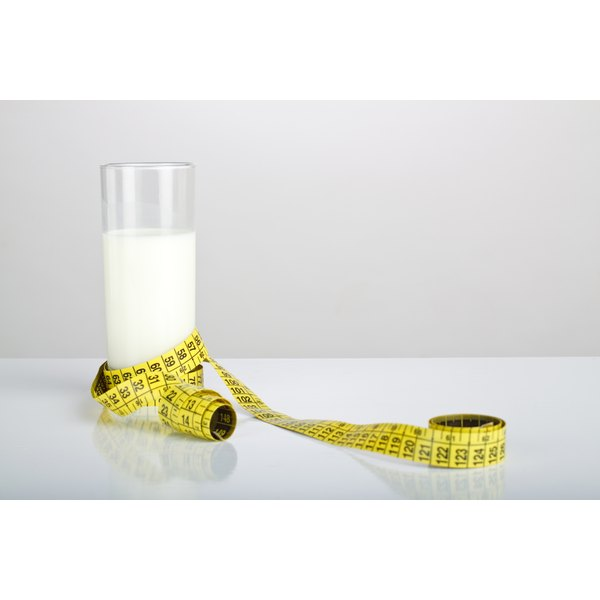 A measuring tape around a vanilla meal replacement drink.