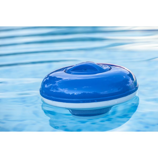 A chlorine dispenser floating on the surface of a pool.