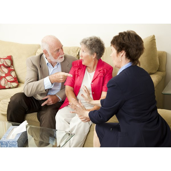 Marriage counselor working with an older couple.