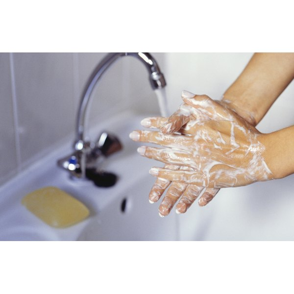 Woman washing her hands in a sink