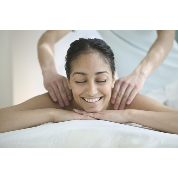 A young woman is receiving a massage.