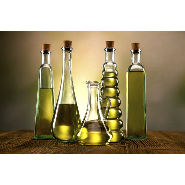 Five different bottles of cooking oils.