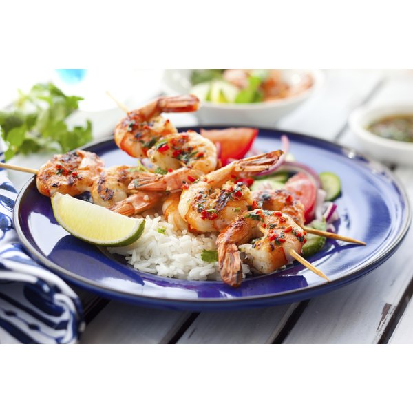 Shrimp skewers on a bed of rice
