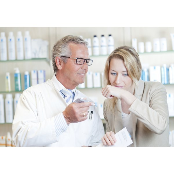 A pharmacist is talking to a client.