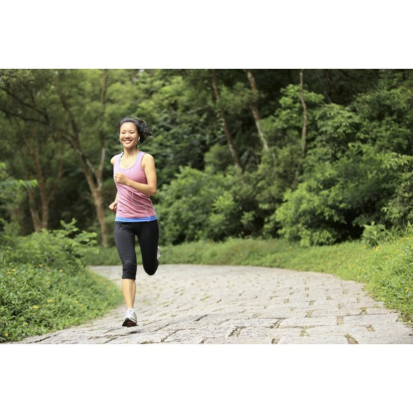 A woman is running on a jogging path.