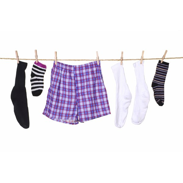 Men's underwear and socks hanging from clothes line.