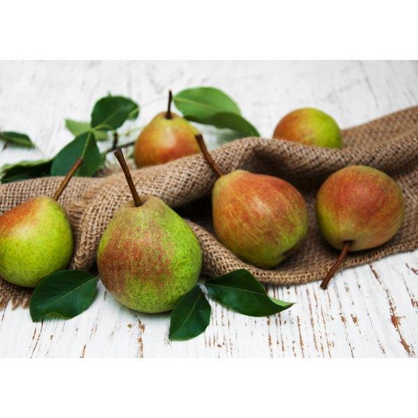 Fresh pears on a wodden table.