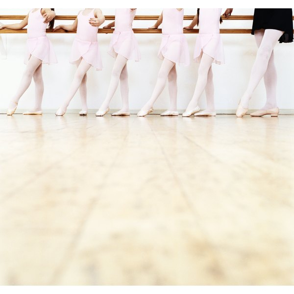 Children doing ballet with instructor, showing lower line.