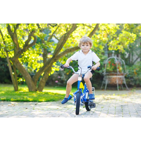 e8ea3cabf83 The Best Bikes for a 5-year-old Boy. By Alice Drinkworth. A young boy is  biking.