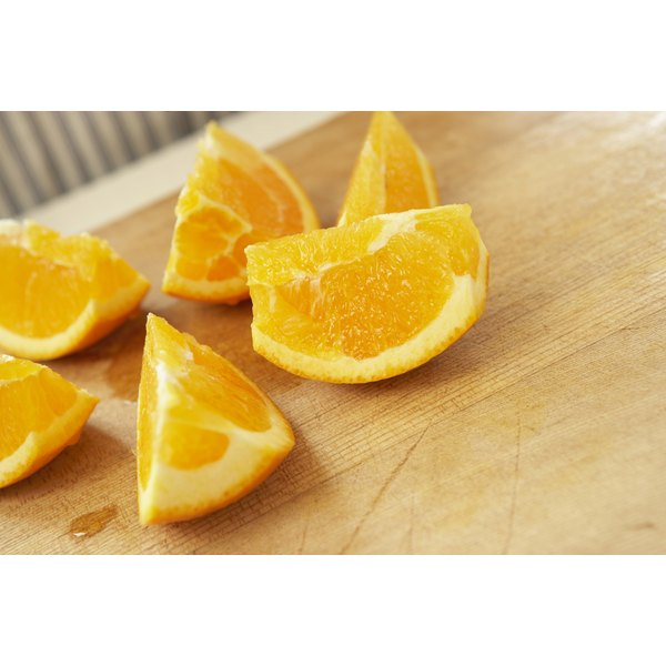 Oranges' vitamin C content boosts your health, but their acid can harm your tooth enamel.