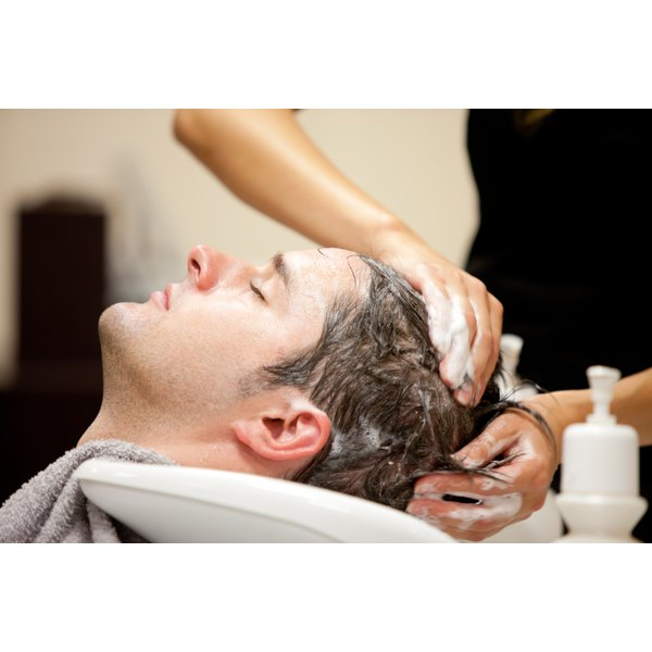 Man getting hair washed at salon