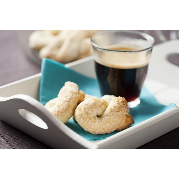 Shortbread cookies and a shot of espresso on a breakfast tray.