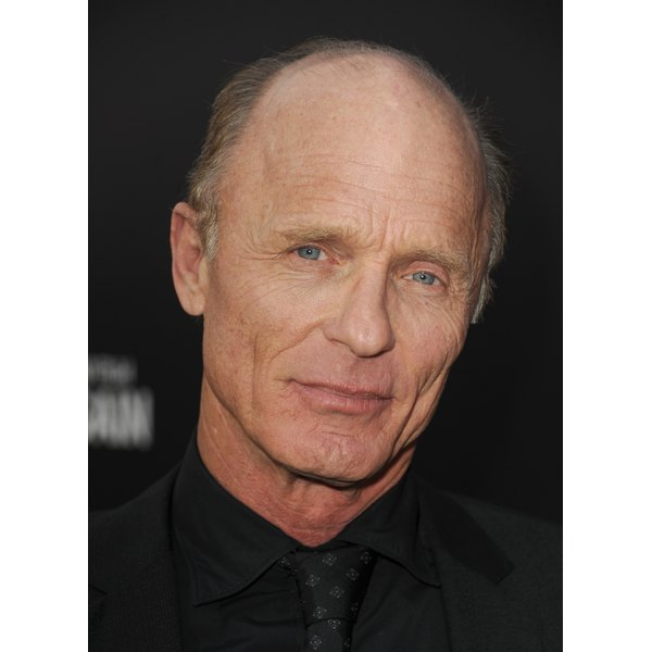 Ed Harris draws attention to his face by keeping his thinning hair tidy.
