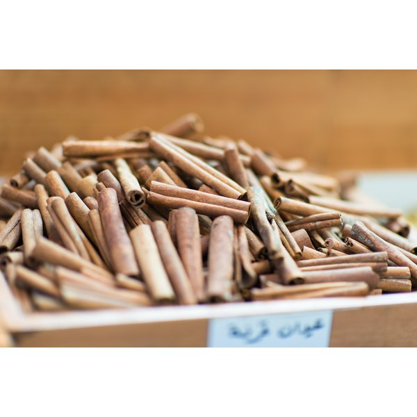 Cinnamon sticks for sale at a market.